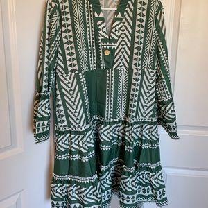 Green dress labeled 2XL but fits like a L